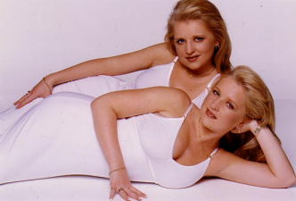 Twins Kerry and Jo Burton adore looking identical so much that they even have their plastic surgery together.