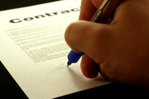 signing a newspaper contract