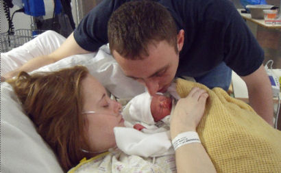 Hollie with baby Shaun and her partner Richard