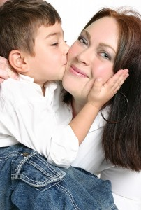bigstock_Child_Giving_Mother_A_Kiss_1082719